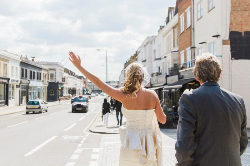 London Bride Hailing A Cab