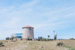 Windmill on Kastos Island, Greece by Maxeen Kim Photography