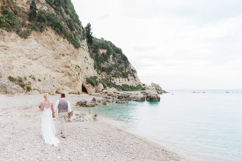 Bride and Groom Walking Along the Beach at Agios Nikitas