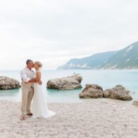 Bride and Groom Kissing on the Beach in Agios Nikitas Lefkada