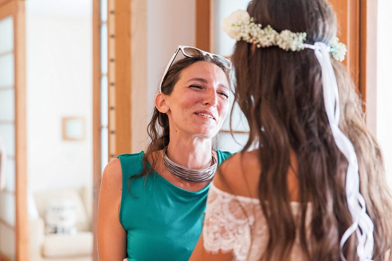 Bridesmaid Smiling at Bride at Ionian Blue