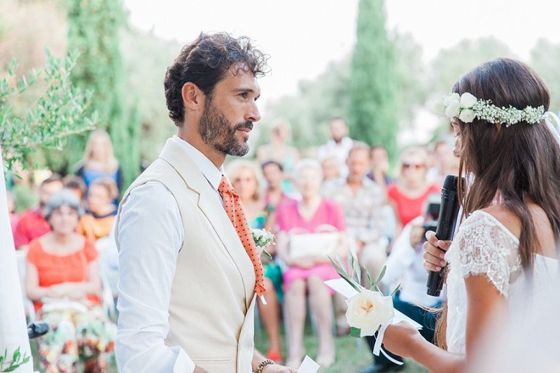 Bride and Groom Exhanging Vows During Their Bohemian Garden Ceremony