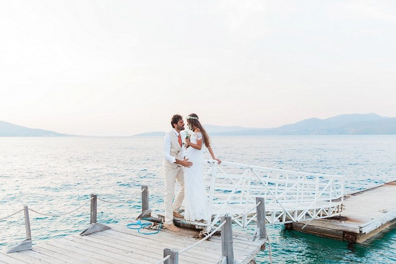 Couple Sharing a Moment on the Jetty at Ionian Blue Hotel