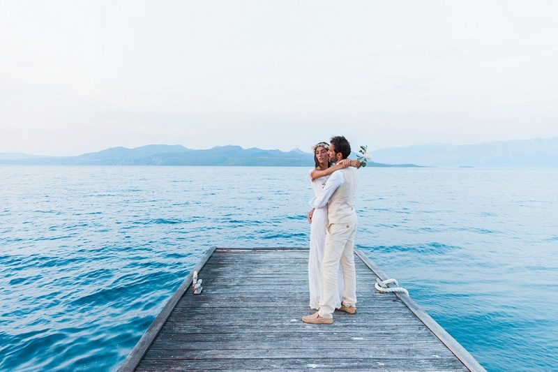 Couple Sharing a Romantic Moment Against the Backdrop of the Ionian Sea