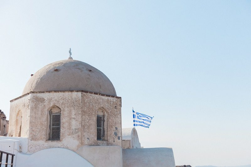 One of the Oldest Churches in Oia Santorini with the Greek Flag Flying