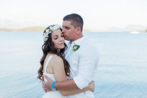 Bride and Groom Hugging After Their Seaside Elopement