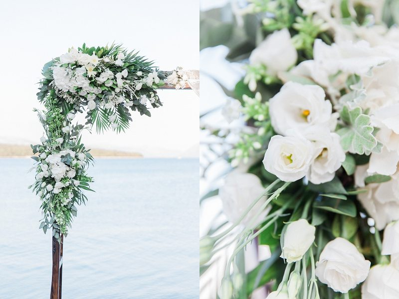 Arch And Flowers In White For a Seaside Elopement
