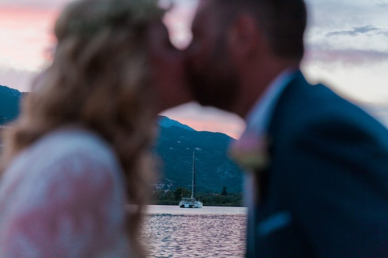 Bride and Groom Kissing on the Jetty at SeaSide Restaurant