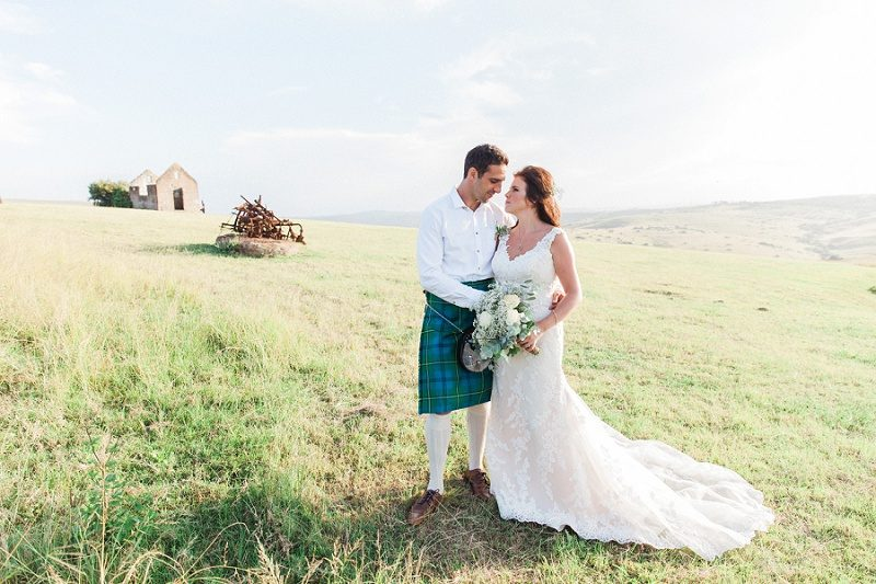 Bride and Groom in a Kilt on the hills at their pistachio and white wedding at Lake Eland Game Reserve