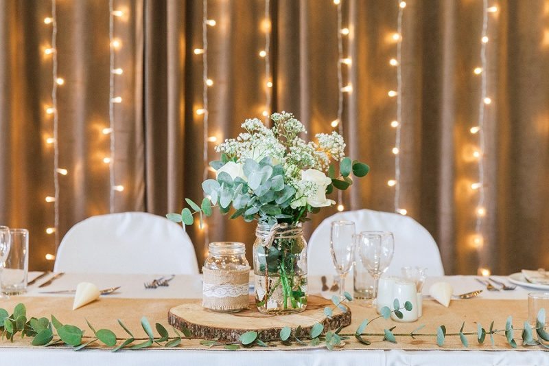 Top Table with Fairy Lights at Pistachio and White Wedding