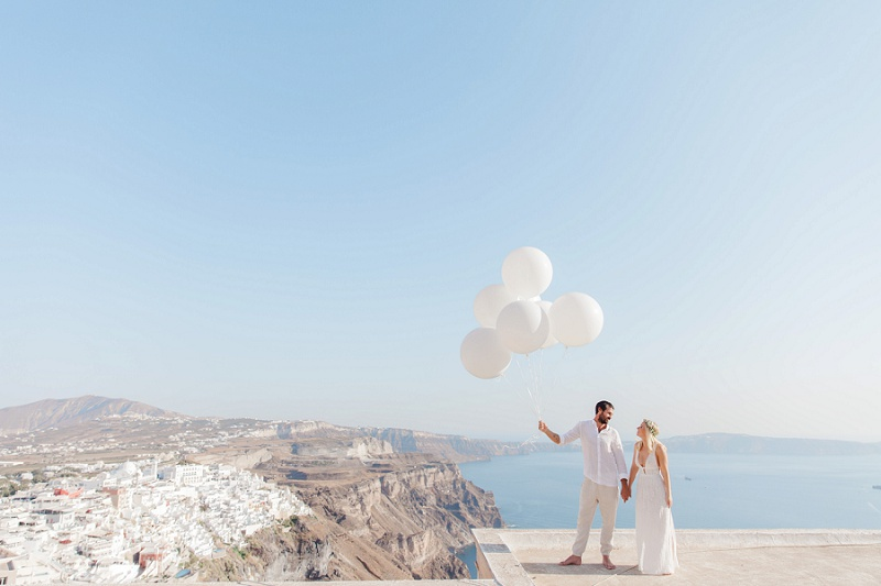 Bride and Groom with Giant White Balloons During their Santorini Elopement