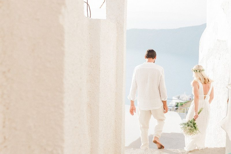 Newlyweds Walking Through The Streets of Fira Santorini