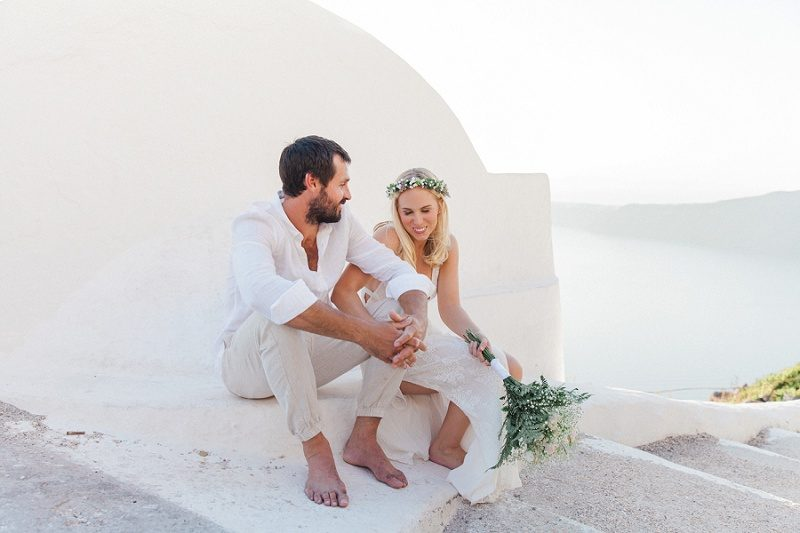Newlyweds Sharing A Laugh On the Steps of Santorini