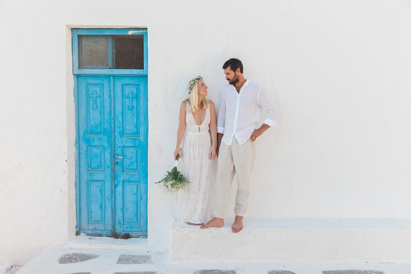 Newlyweds Outside a Blue and White Church In Santorini