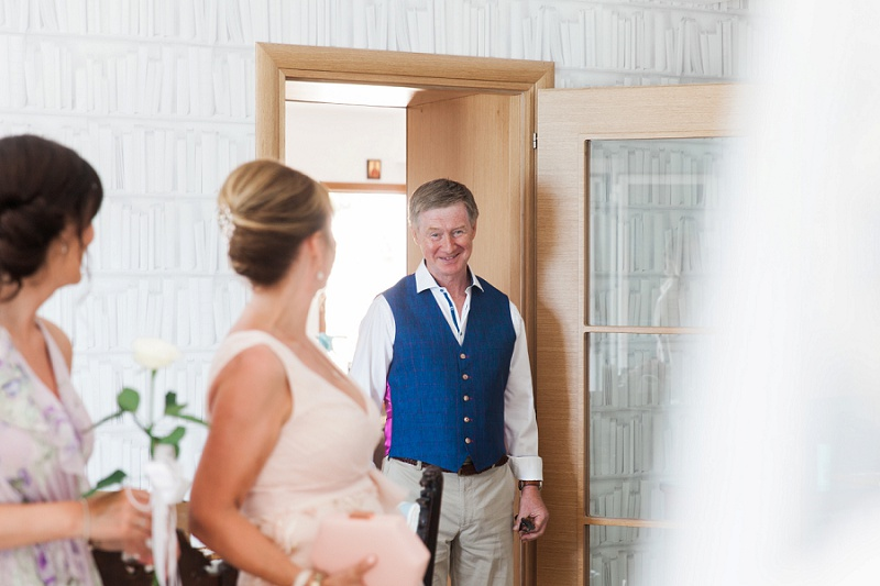 Emotional father of the bride as he sees his daughter in her dress