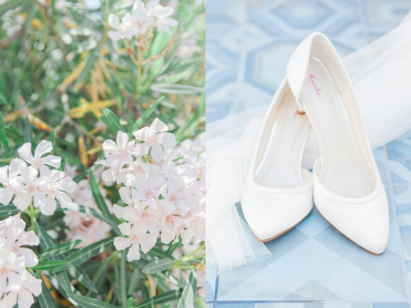 Brides white high heels and veil against blue tiles