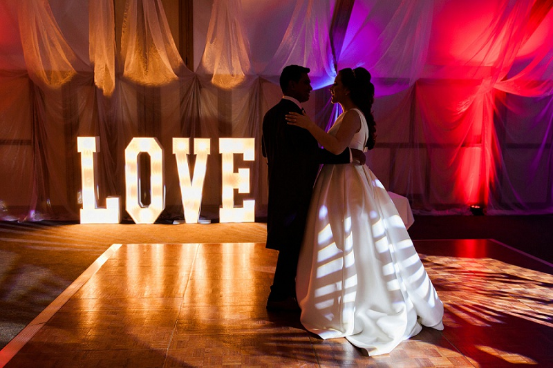Bride and Groom with LOVE lights on the Dance floor at their wedding at Warren House