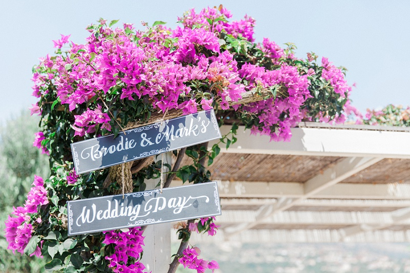 Purple bougainvillea and chalk board wedding signs at Villa Rosa on Kefalonia