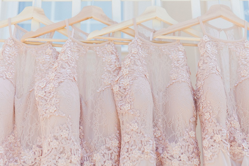 Soft pink bridesmaids dresses hanging in a row at Villa Rosa on Kefalonia